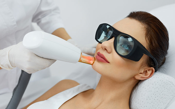cosmetic laser procedures beautician uses skin