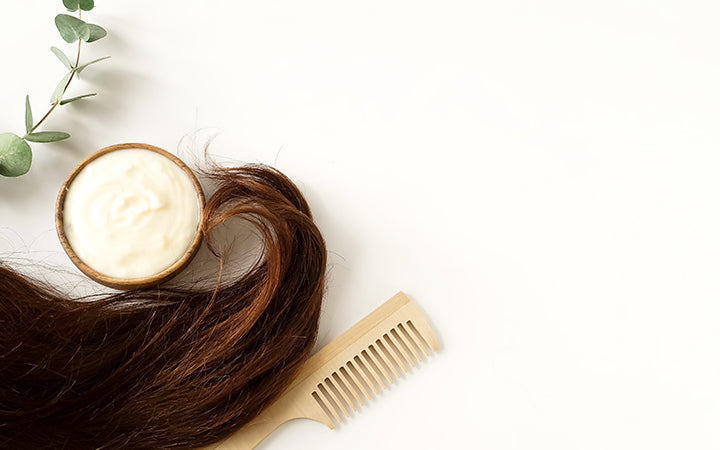 female hair hair mask and bamboo comb on top view