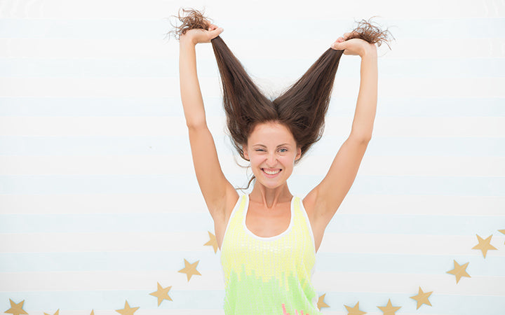 happy woman holding her hair