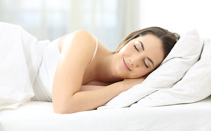 satisfied woman sleeping in a comfortable bed
