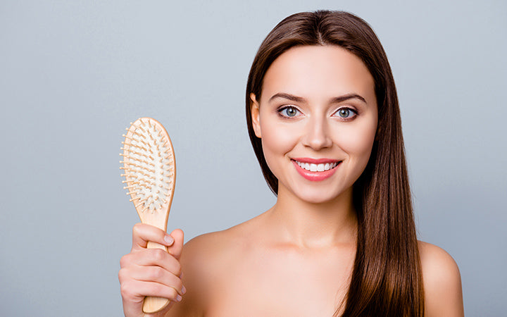 woman showing a comb without hairs on it