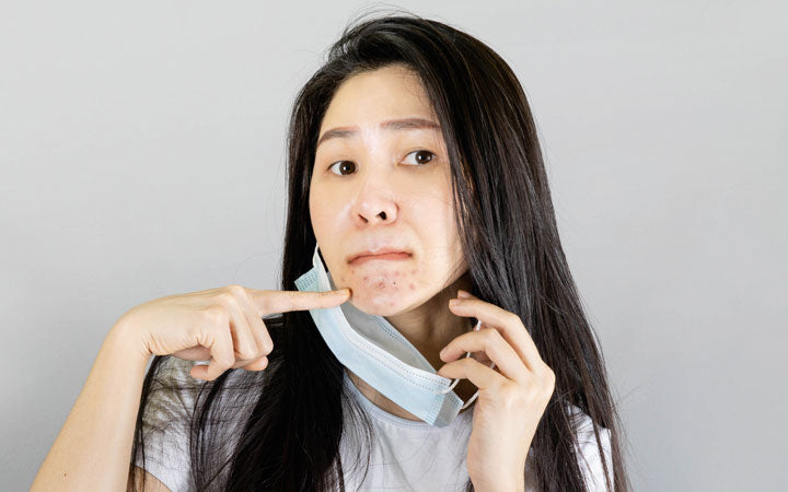 young asian woman wearing medical face mask