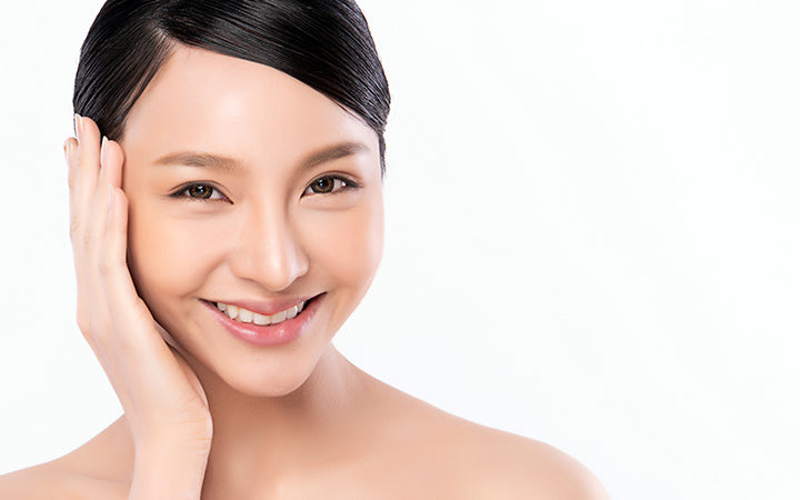 young asian woman with clean fresh skin