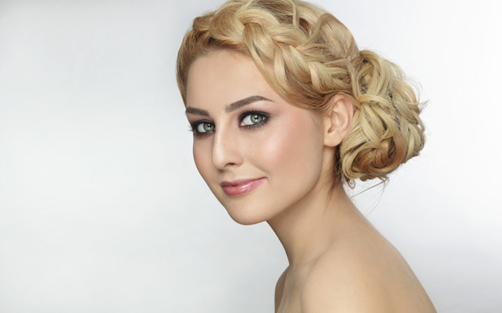 young beautiful blonde woman with stylish prom hairdo