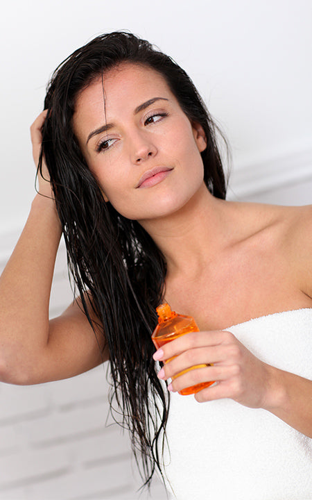 young woman holding scented oil