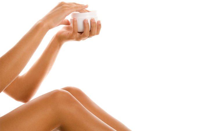 Young woman with jar of body lotion