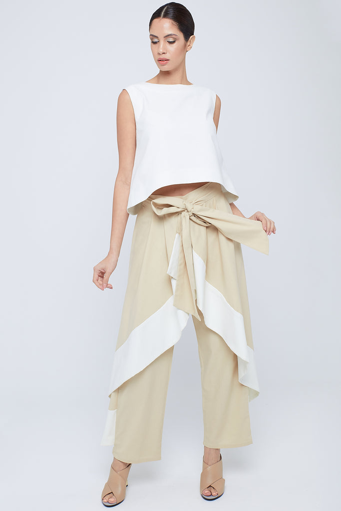 Sleeveless linen top  with overlapped back  secured with pearl stud