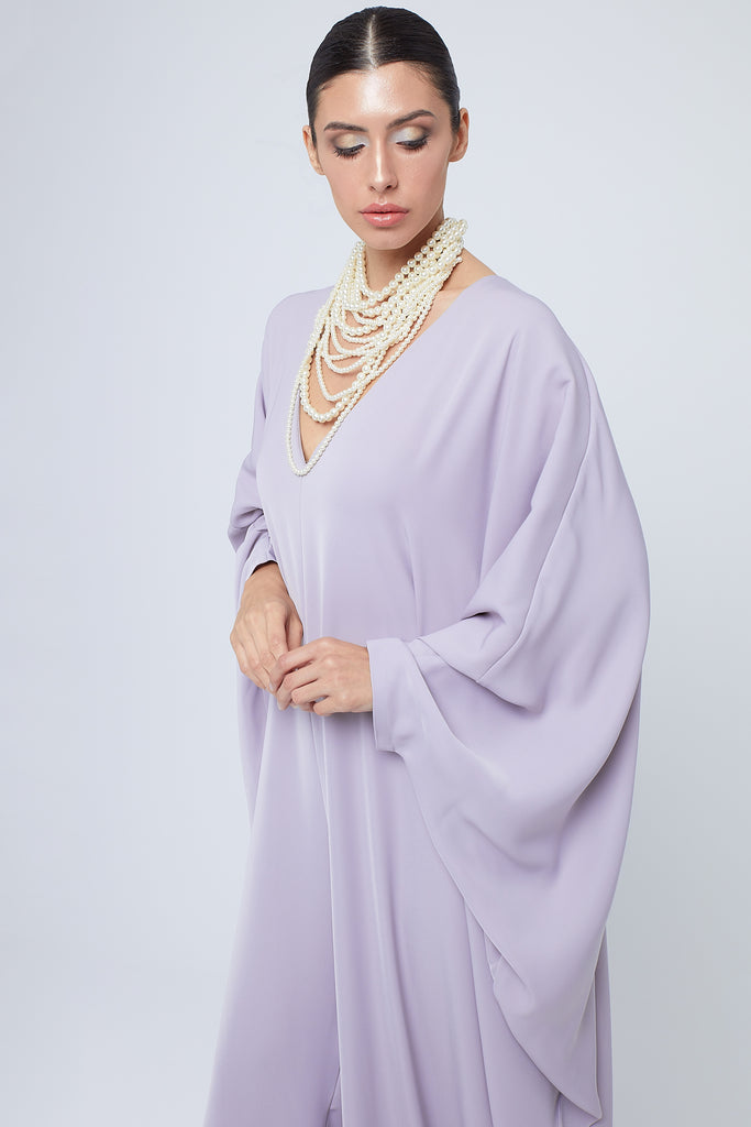 Oversize silk crepe jumpsuit with oversize pearl necklace