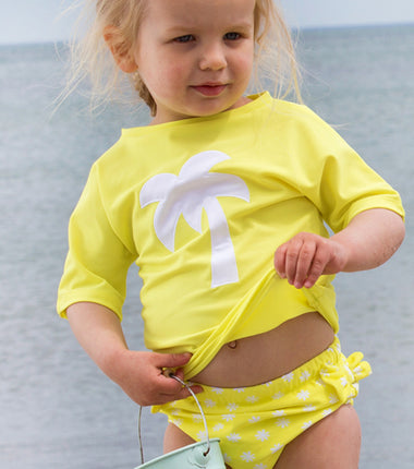 Petit Crabe swimming nappies for babies with loop in the side seam in canary yellow