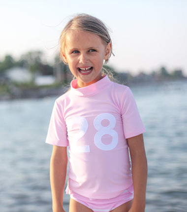 Petit Crabe turtleneck short sleeve swim shirt in pink