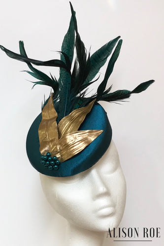 Teal green headpiece for hire