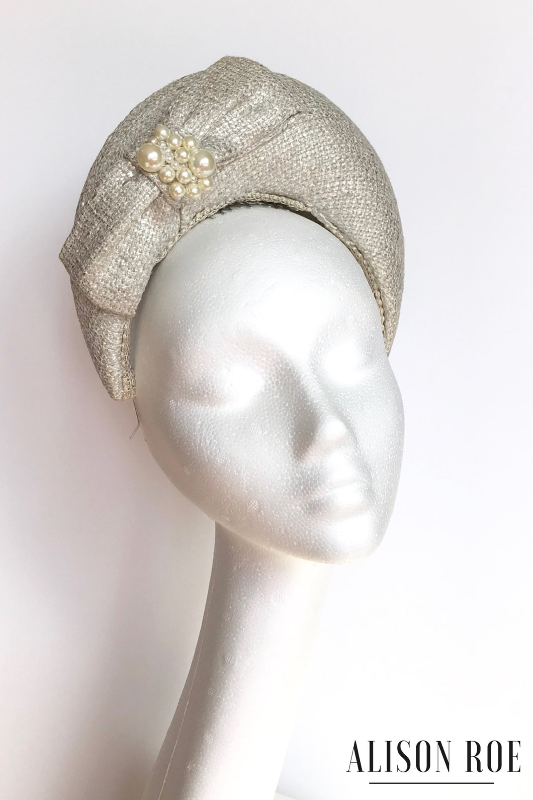 Cream headpiece for hire - tipperary hat hire