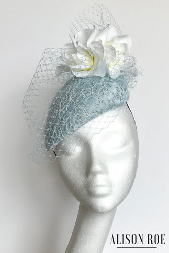 Pale blue designer headpiece for hire