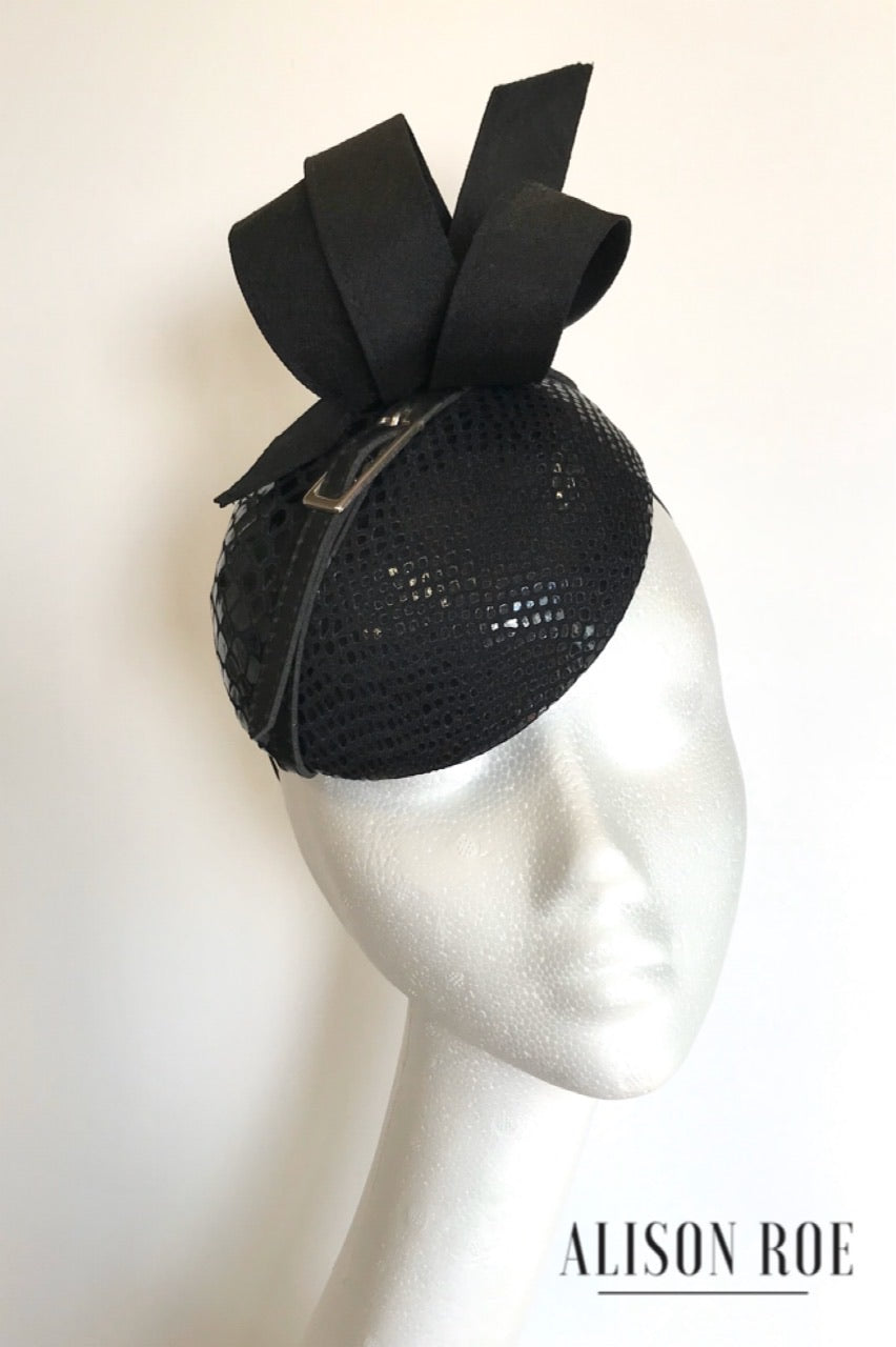 Black faux snakeskin headpiece to hire. Alison Roe Hat Hire Tipperary