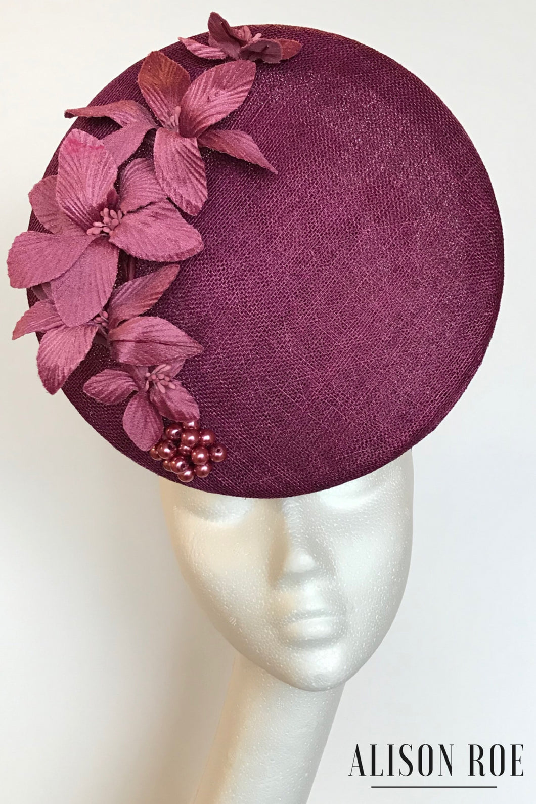 aubergine pink designer hat to hire