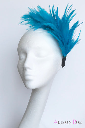 Turquoise feather crown for hire