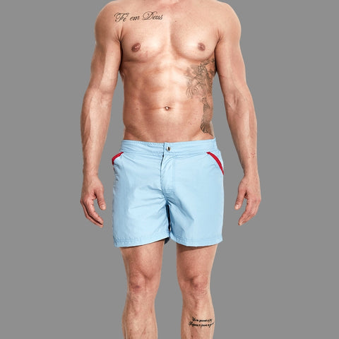 Summer Daze light blue men's swim shorts with zipping fly and snap button by Ochox