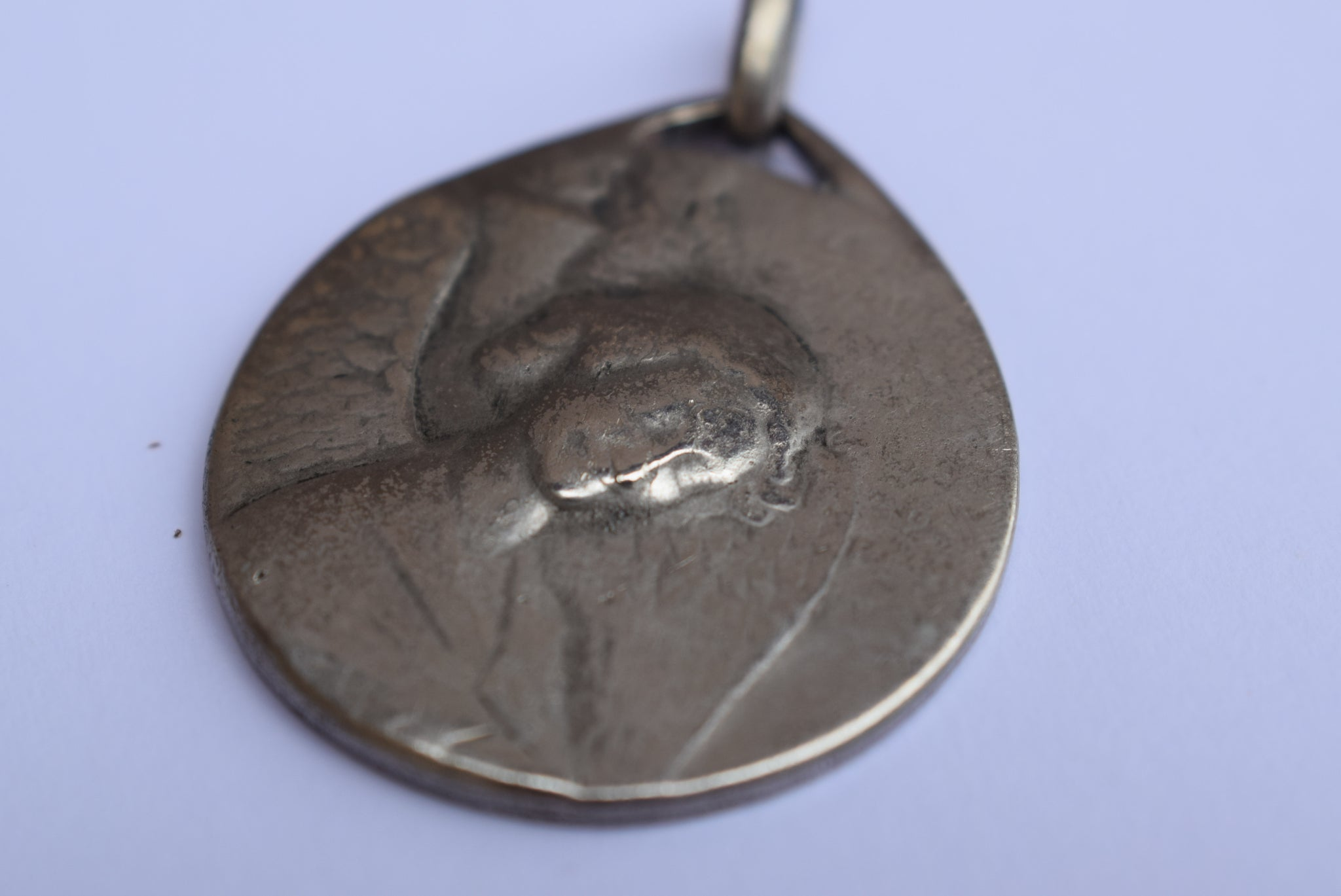Smiling Angel Medal by Ovide Yencesse - Charmantiques