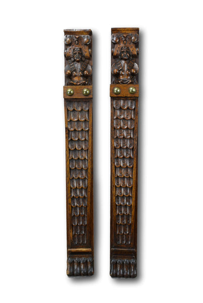 Pair of Figural Wood Pillars - Charmantiques