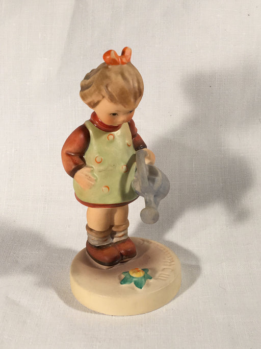 "Goebel Hummel TMK5 #74 ""Little Gardener"" (Girl Watering Flowers) 4.5"" Tall   - TvMovieCards.com"