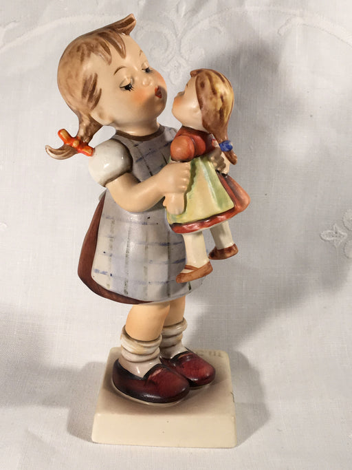 "Goebel Hummel TMK4 #311 ""Kiss Me"" (Girl with Doll) 6"" Tall   - TvMovieCards.com"