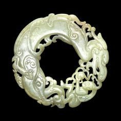 Dragons, like the one depicted in this jade pendant, were among the most favored symbols in ancient Chinese jewelry.