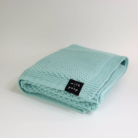 Mint merino baby blanket from Milk and Poop