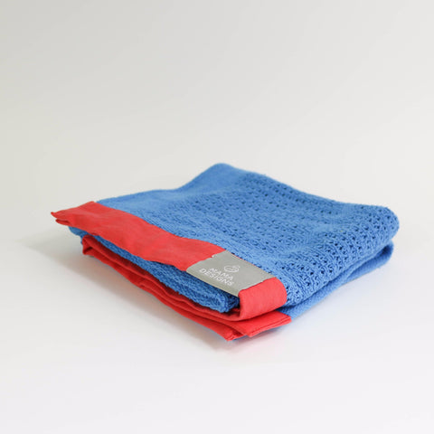 Cellular blanket blue with red trim