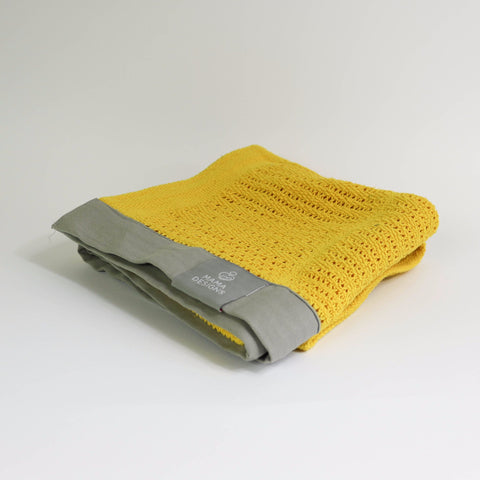 Cellular blanket yellow with grey trim