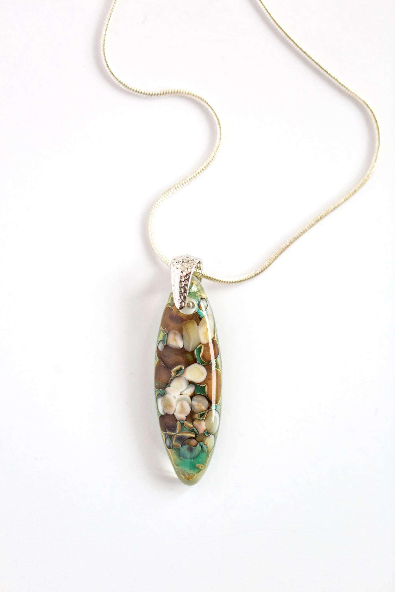 "Floating Pebbles Almond-Shaped Fused Glass Pendant Necklace / Teal + White + Ivory + Tan + Brown Fused Glass / Silver-plated nickel-free pinch bail / Silver-plated nickel-free 16-18"" snake chain necklace"