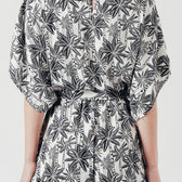 Frill Playsuit with Waist Tie in White/Black Palm Print