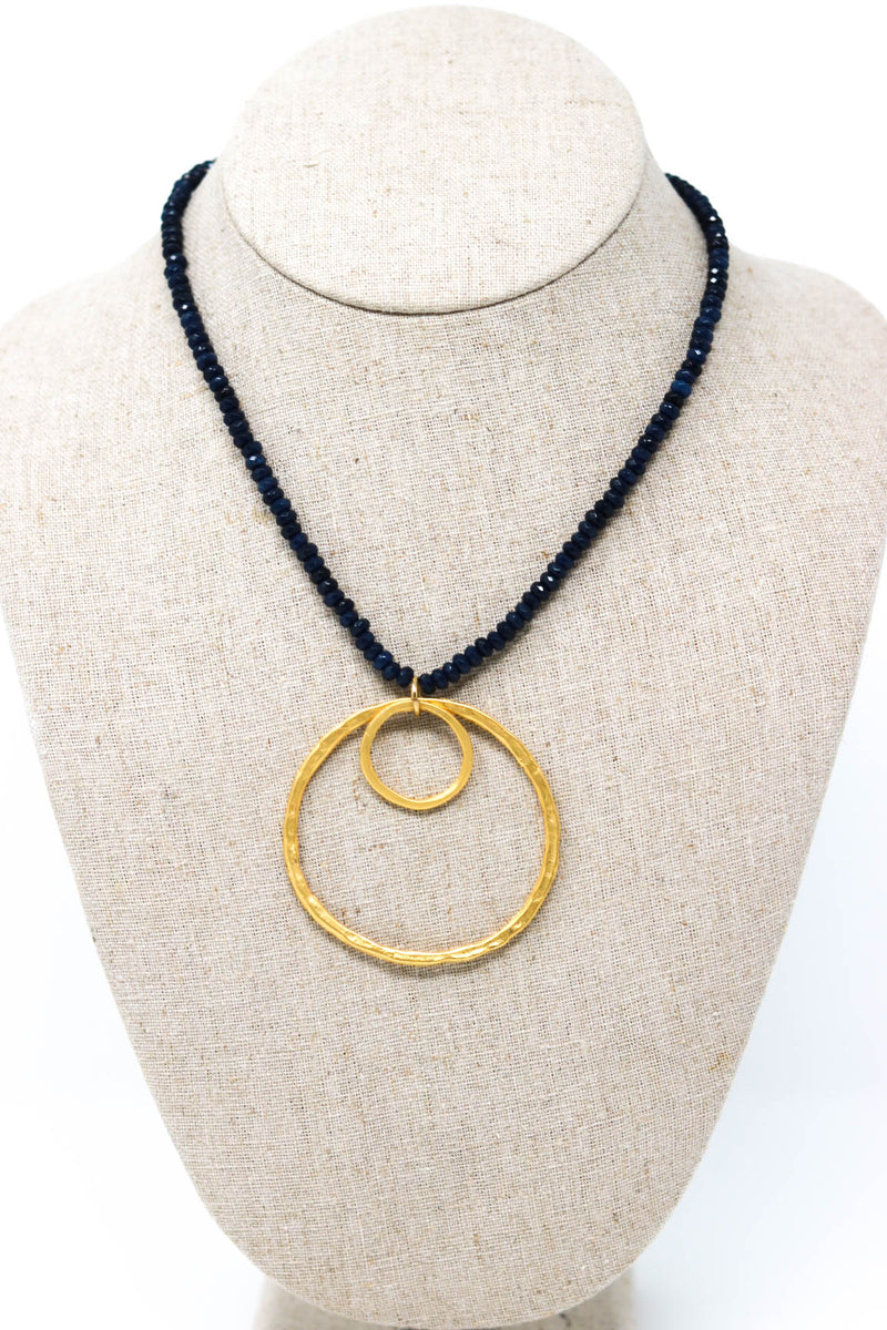 "Double Circles On Navy Blue Beads. ""Wink On"""