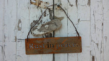 Rust in peace. Rustic hanging metal sign