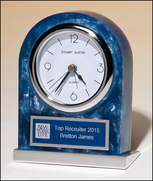 Acrylic clock with polished silver aluminum base. Silver bezel, white dial, three-hand movement.
