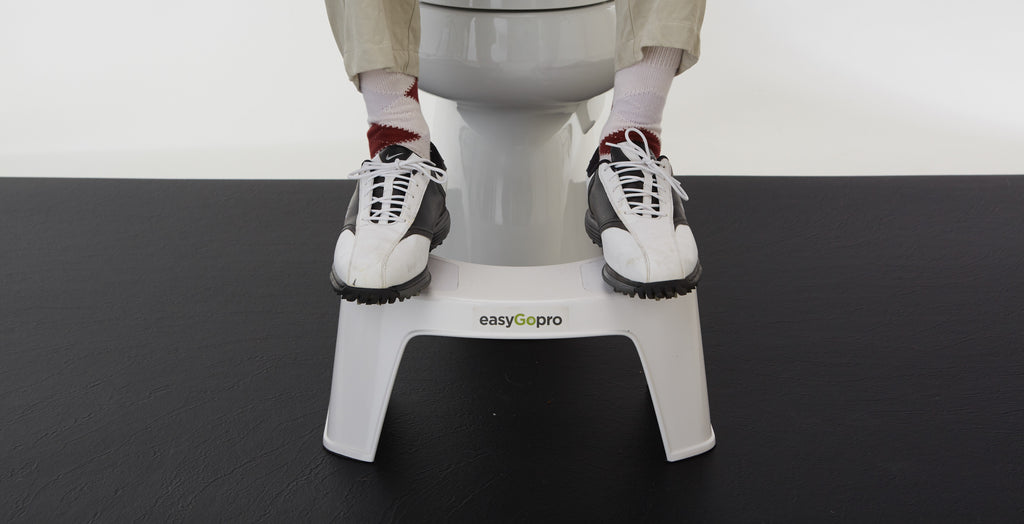 "<img src=""toiletstool.jpg"" alt=""white easyGopro with a man's legs and feet resting on the toilet stool while sitting on the toilet wearing Nike golf shoes argyle socks and khaki pants"">"