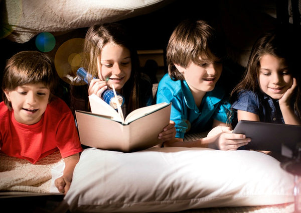 Kids in a pillow fort reading