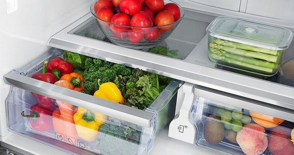 Vegetables stored in the refrigerator's crisper drawer.