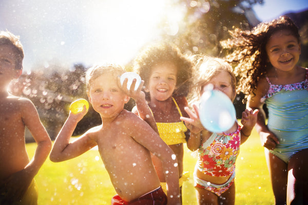 Kids having fun at a water balloon party