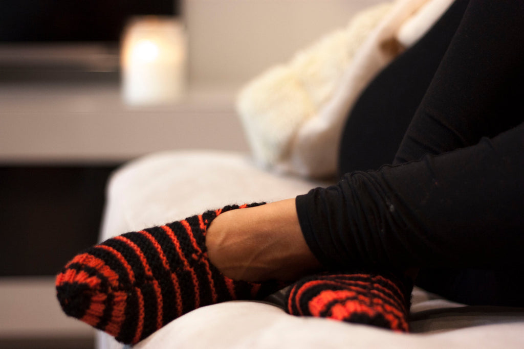 Black + Orange Striped Hand-Knitted Socks by Made With a Purpose - Jewel and Lotus