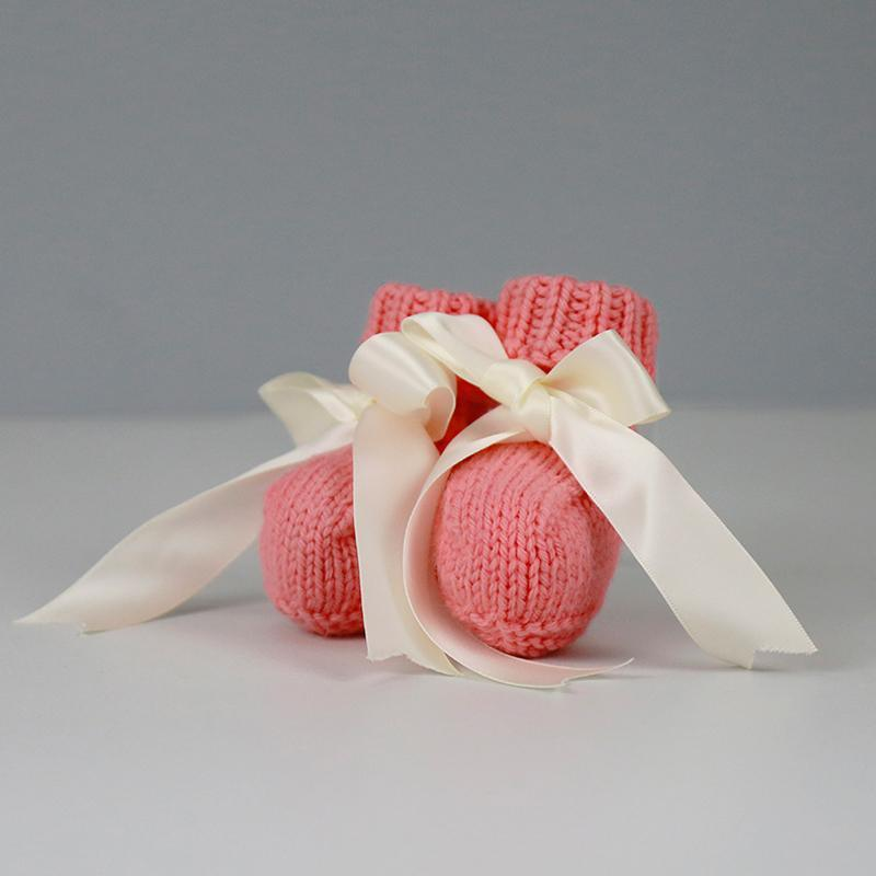 Grace Hand Knitted Baby Booties in Coral with Cream Satin Ribbon