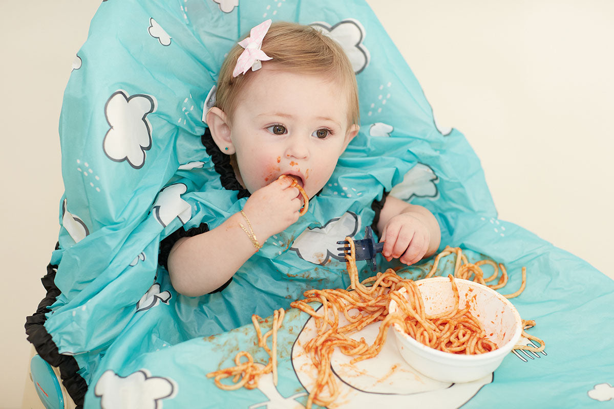 Baby Wearing Teal All Over Bib Eating Messy Food