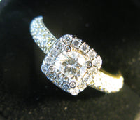 Half Ct centre Diamond Halo & Pava set diamonds in shank