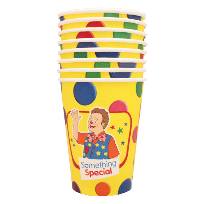 a stack of paper cups featuring mr tumble on a yellow background
