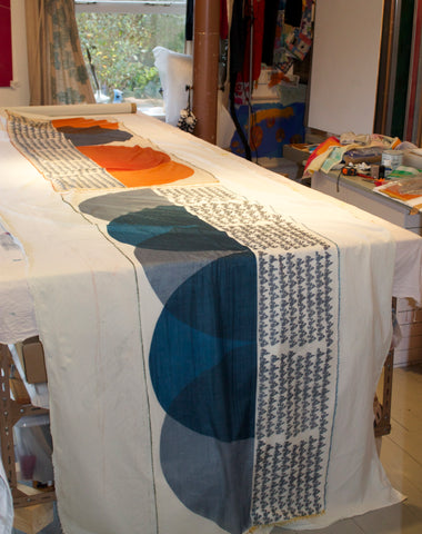 Jane Keith - Cashmere scarves drying after steaming process on table