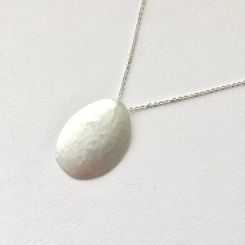 Convex Ovum Hammered Pendant by Wyckoff Smith Jewellery - Anti Anxiety Jewellery