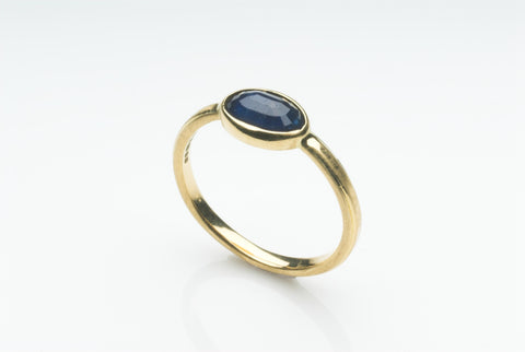 Sapphire and 18 ct gold engagement ring