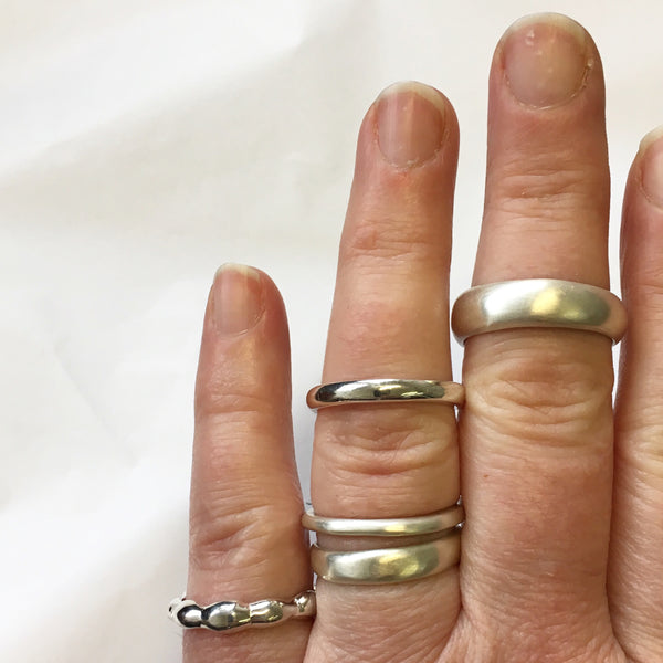 Assorted organic shape silver stacking rings by Michele Wyckoff Smith available on www.wyckoffsmith.com