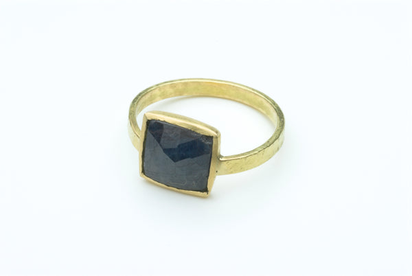 Faceted square rough sapphire in 18 ct gold by www.wyckoffsmith.com.