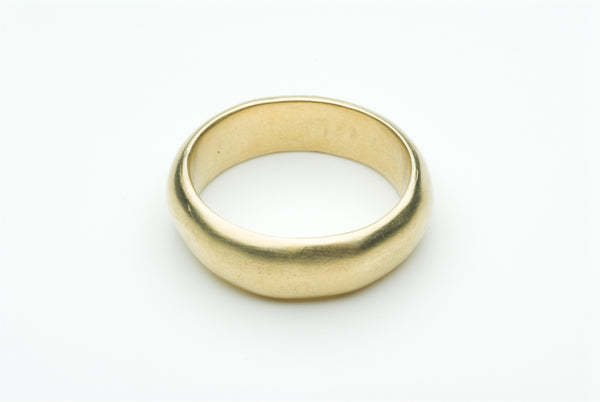 Gold Horatio wedding ring by Michele Wyckoff Smith.