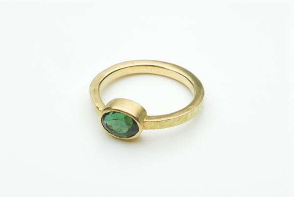 Green faceted tourmaline ring by Michele Wyckoff Smith.